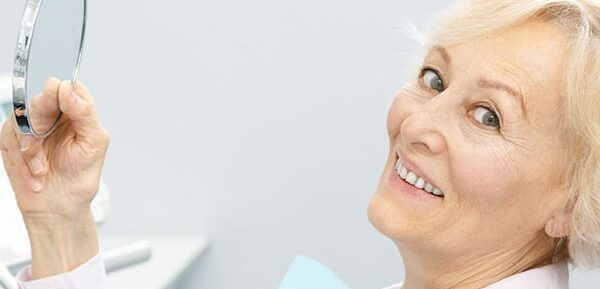 implant denture cost in Canada